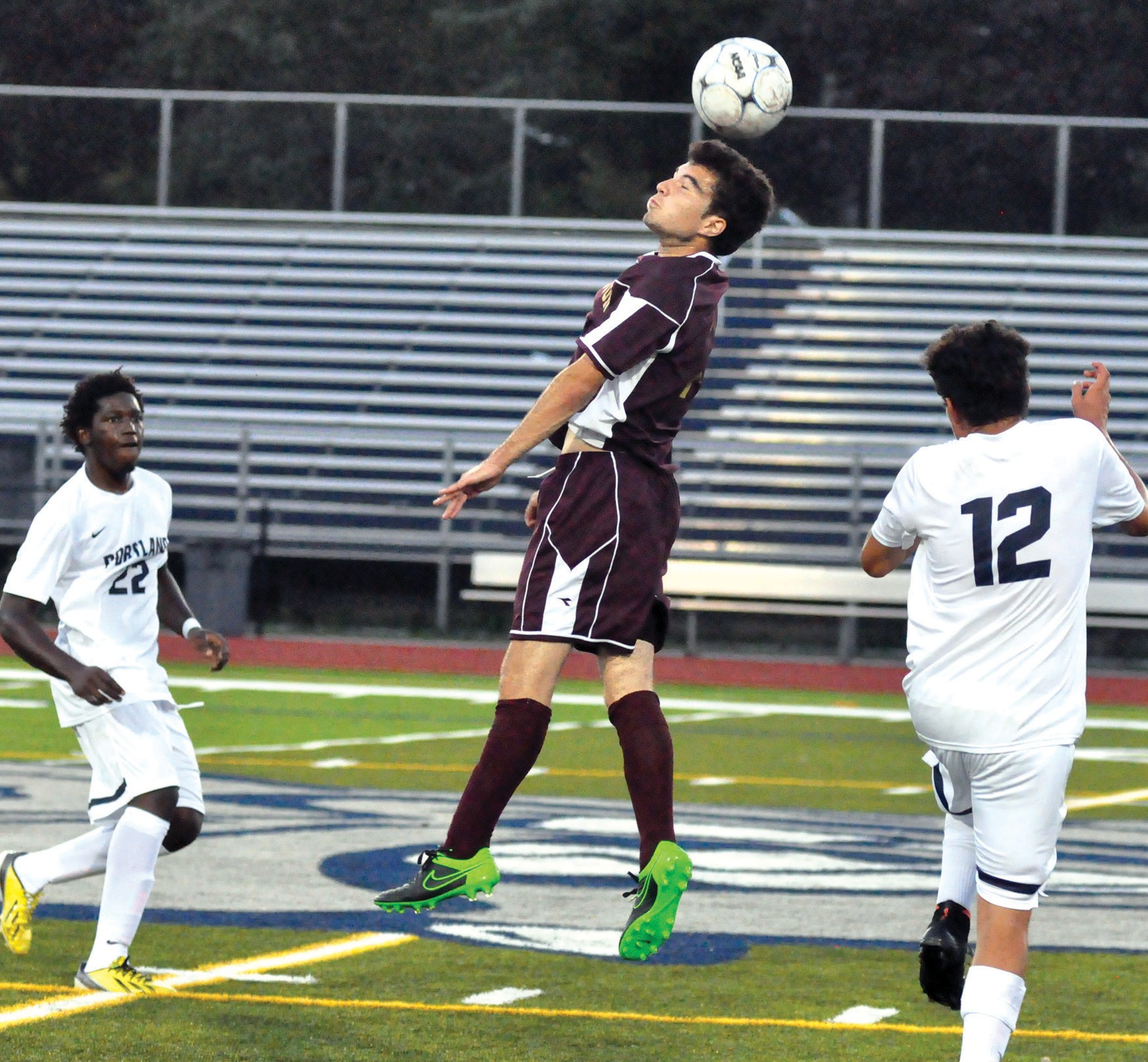 Thornton Academy's Cameron Twombly, center, heads the ball between Portland's Wade Faria (22) and Erick Molina-Garcia (12) during the Trojans' 0-0 draw with Portland at Fitzpatrick Stadium in Portland Tuesday.