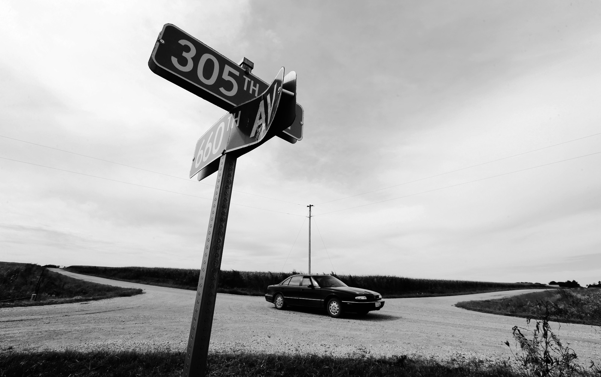On Sept. 8, a car passes through an uncontrolled rural intersection where a driver was killed in an August crash near Maxwell, Iowa.