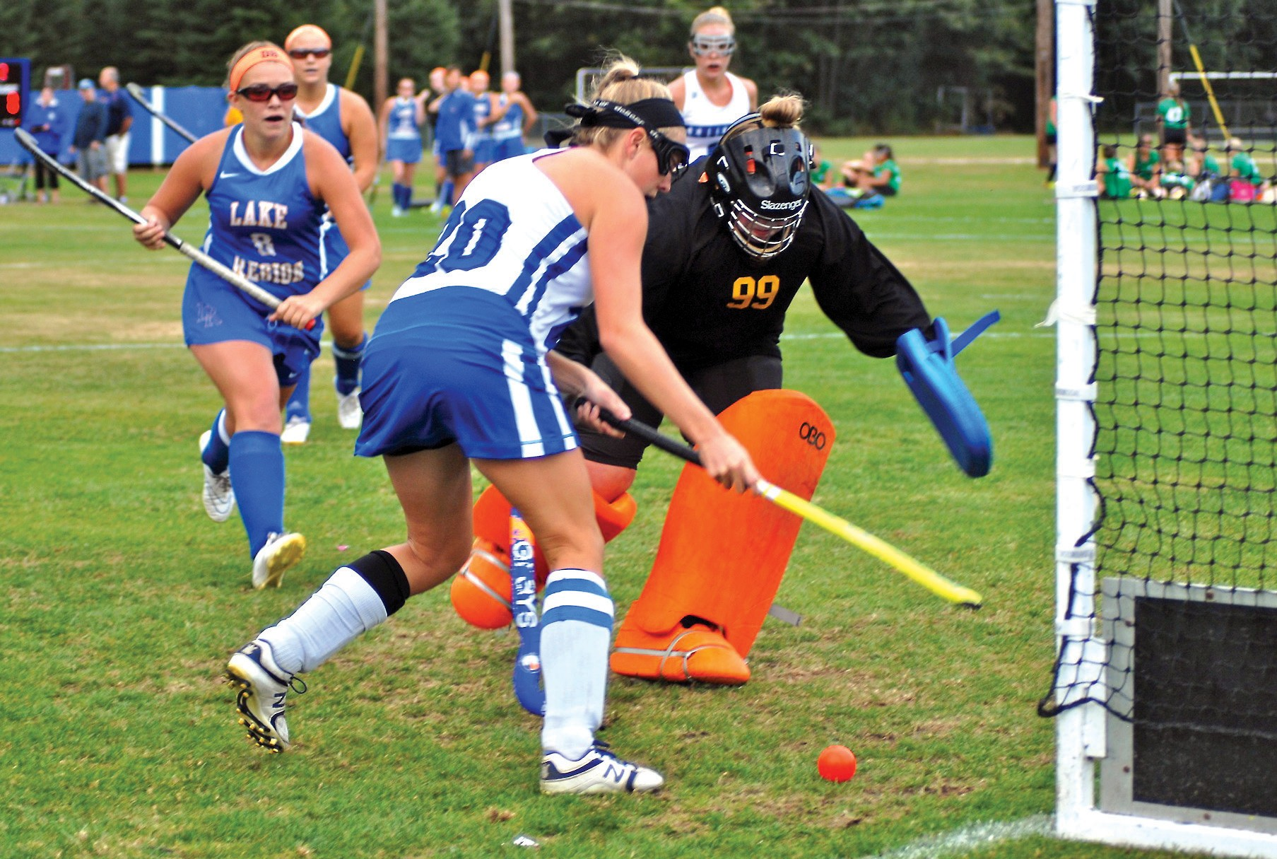 All Lake Region goalie Maddie Nelson can do is watch as Kennebunk's Liv Sandford sends home the game-winning goal on Tuesday.
