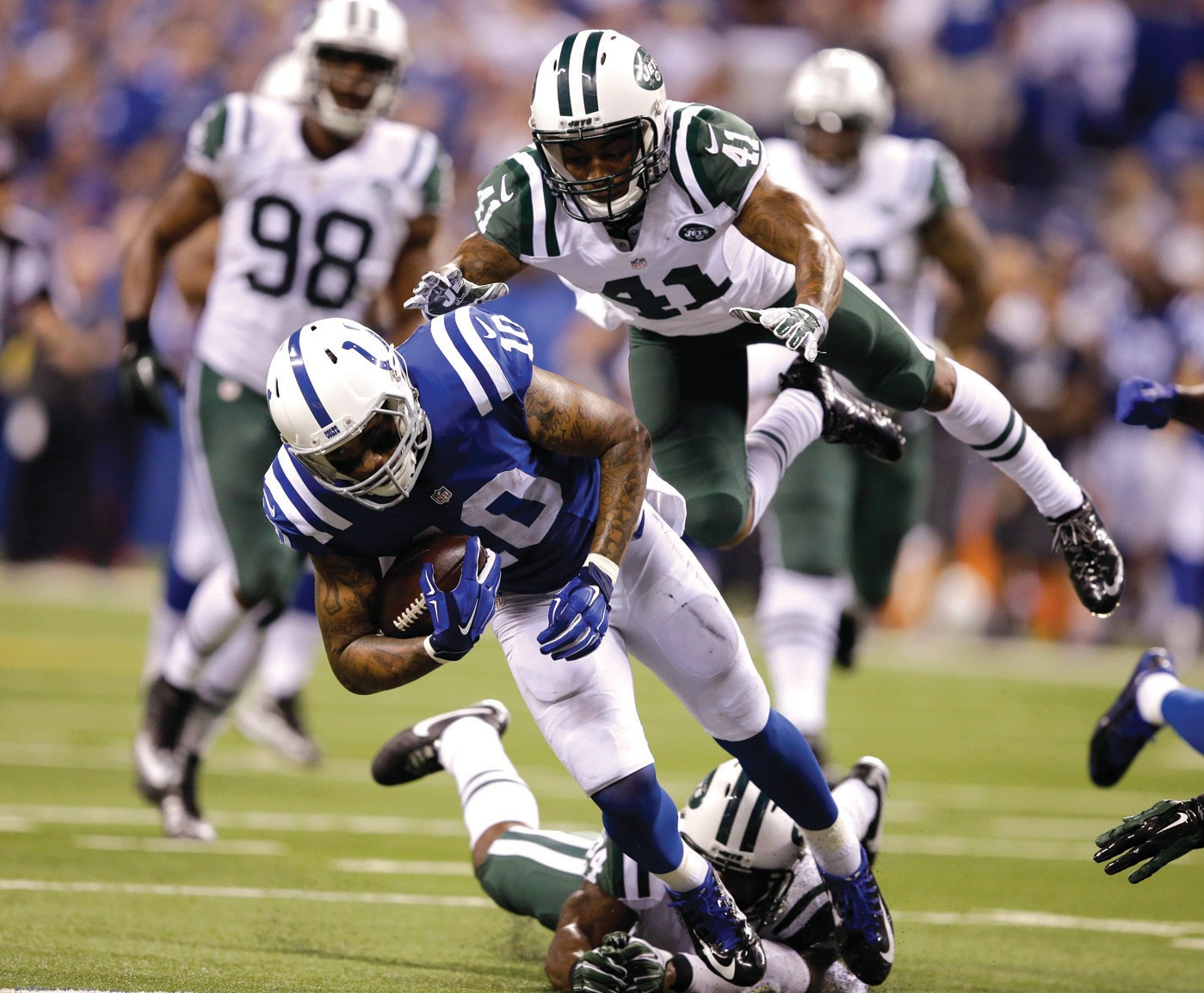 New York Jets defensive back Buster Skrine (41) and New York Jets cornerback Darrelle Revis (24) dive to tackle Indianapolis Colts wide receiver Donte Moncrief (10) during the second half of an NFL football game in Indianapolis, Monday.