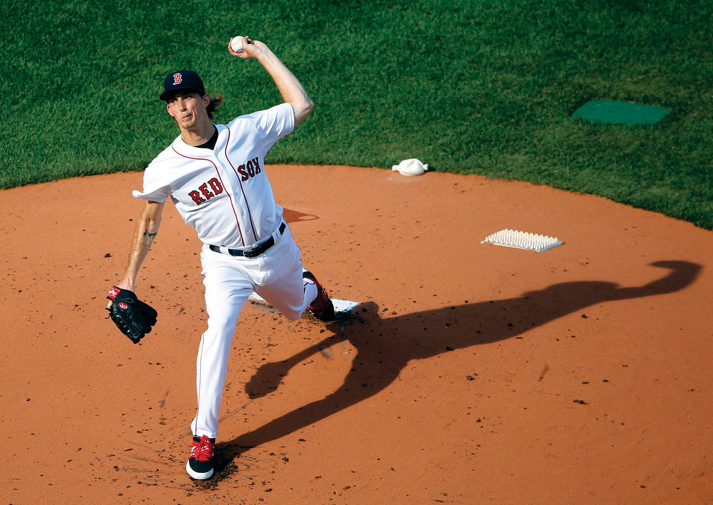 Boston Red Sox starting pitcher Henry Owens delivers against the New York Yankees during the first inning of a baseball game at Fenway Park in Boston Wednesday.