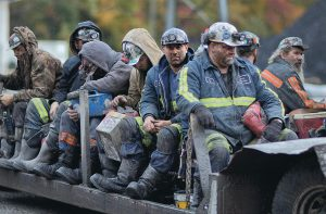 IN THIS OCT. 15, 2014, PHOTO, coal miners return on a buggy after working a shift underground at the Perkins Branch Coal Mine in Cumberland, Ky. As recently as the late 1970s, there were more than 350 mines operating at any given time in Harlan County.