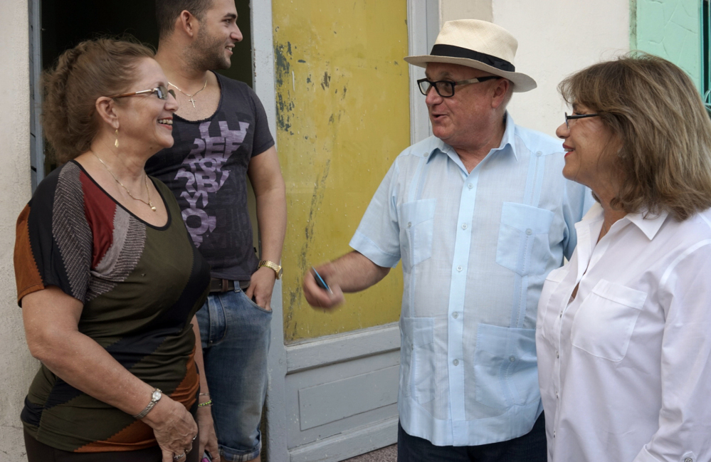 Berta Luisa Fernandez, left, reunites with cousin Olga Maria Saladrigas and her husband, Carlos Saladrigas, in Holguin, Cuba, Monday. Saladrigas' family fled to Miami after the 1959 revolution.