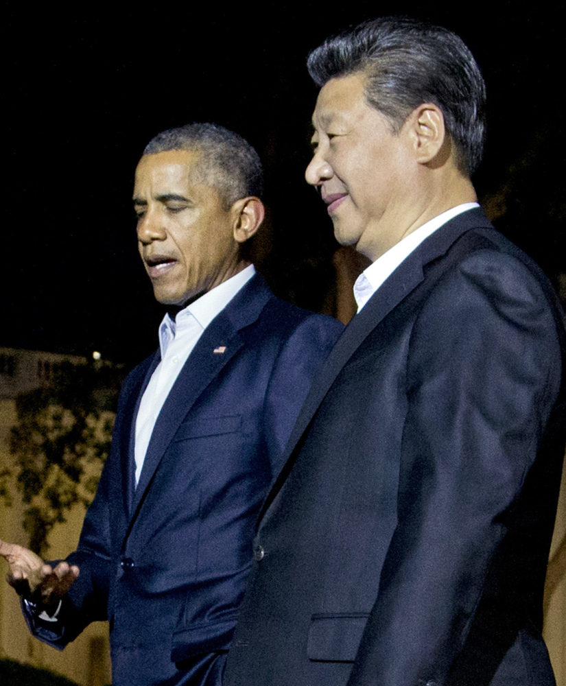 President Obama and Chinese President Xi Jinping, right, stroll outside the White House on Thursday.