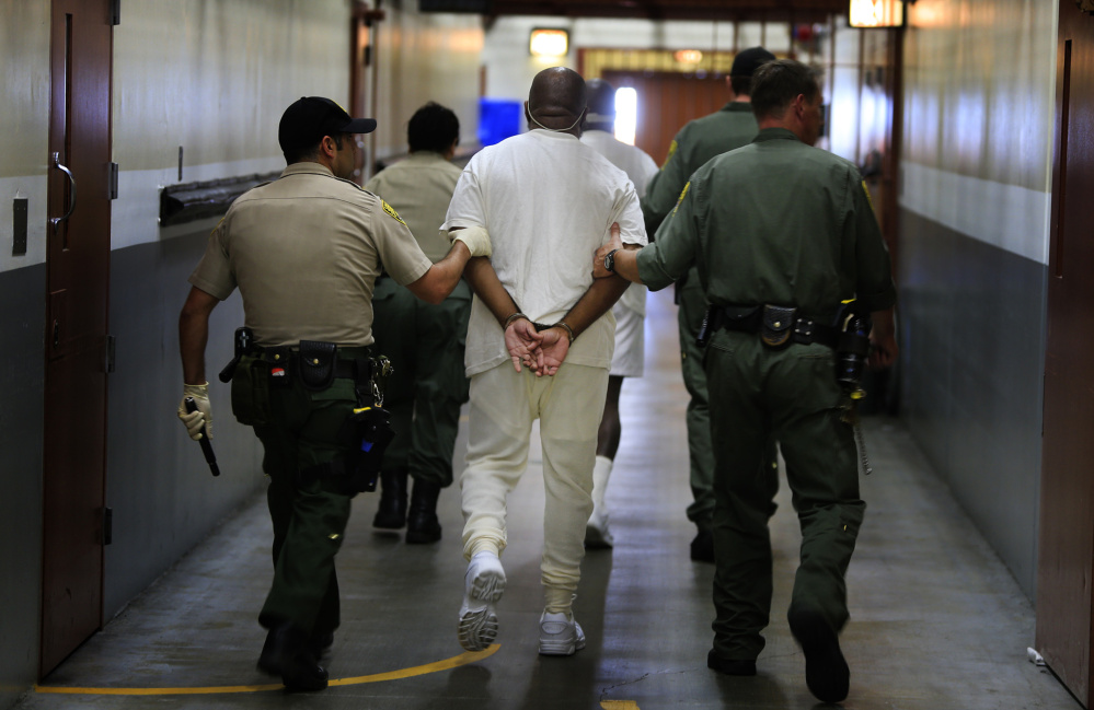 Inmates are walked to a medical unit at Pelican Bay State Prison, Crescent City, Calif. There have been recent efforts to free nonviolent offenders serving disproportionate sentences.