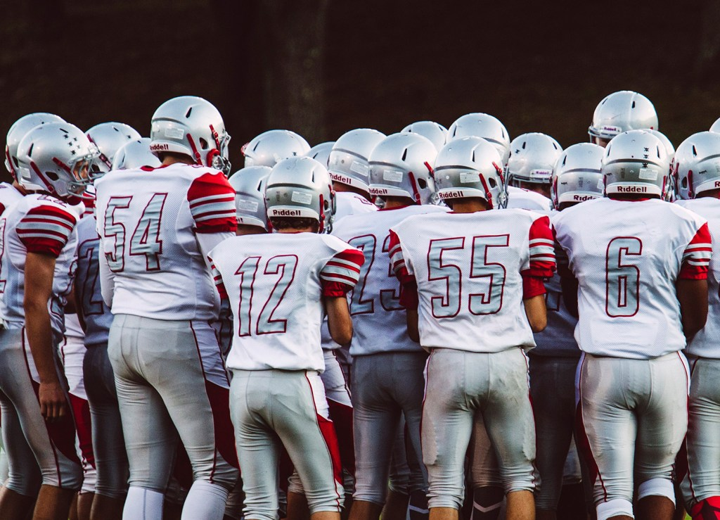 South Portland High School football players gather before their game Friday night in Sanford. One player was suspended Friday for what Superintendent Ken Kunin described as a hazing incident. Whitney Hayward/Staff Photographer