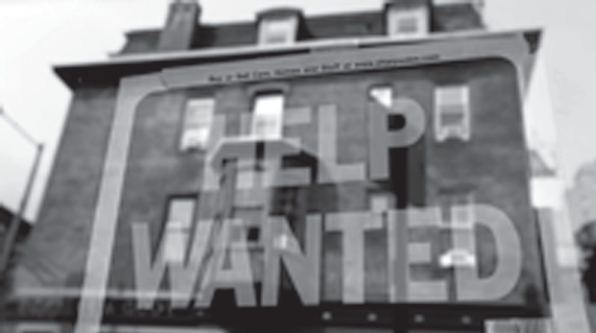 In this 2013 file photo, a Philadelphia business displays a help wanted sign in its storefront.