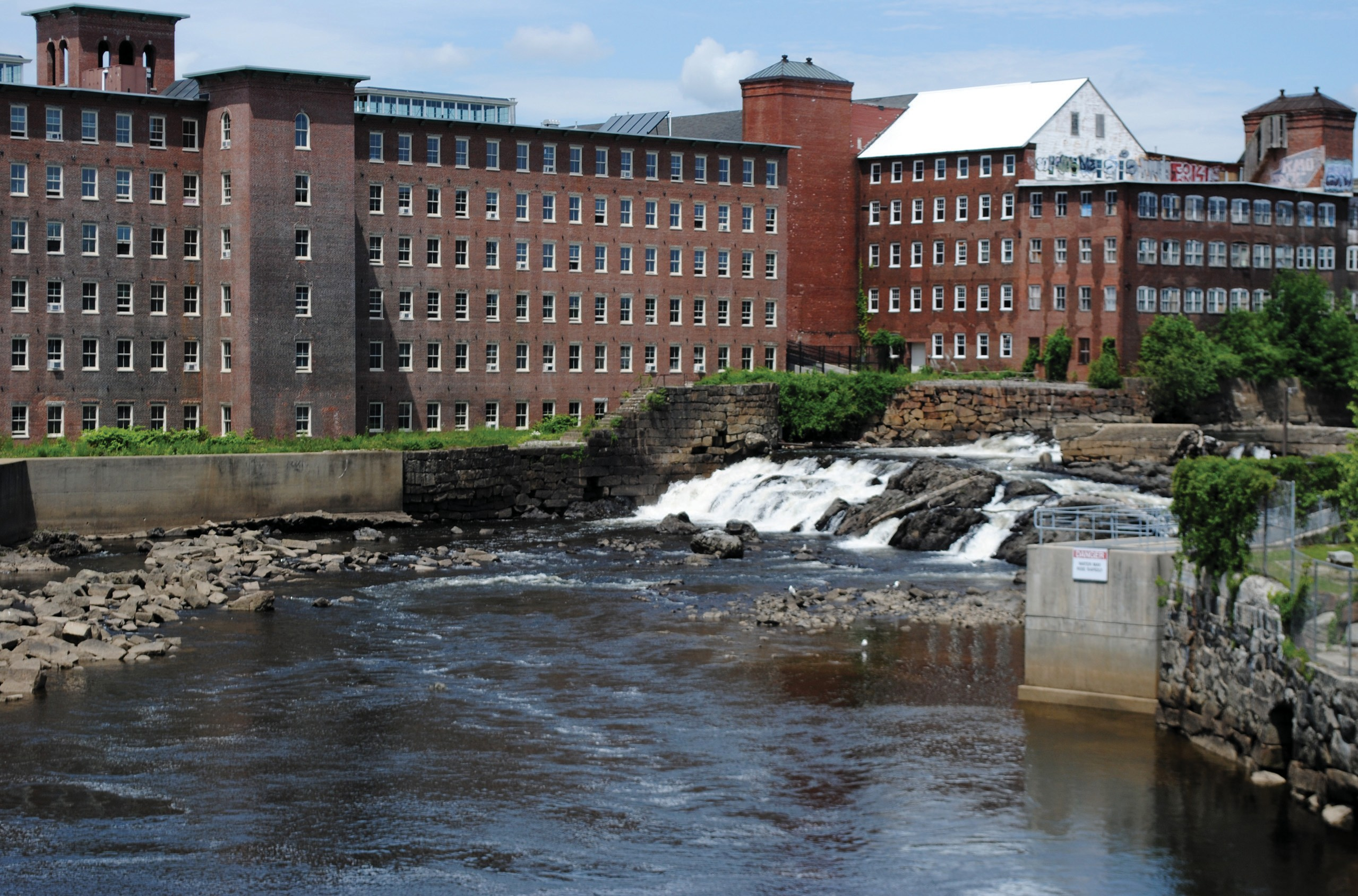 The Saco River is pictured from the RiverWalk pedestrian bridge in this July file photo. A law that will take effect next week will allow the RiverWalk to be cantilevered over a portion of the river, connecting the pedestrian bridge to a park that will be added to the former Maine Energy Recovery Company site.