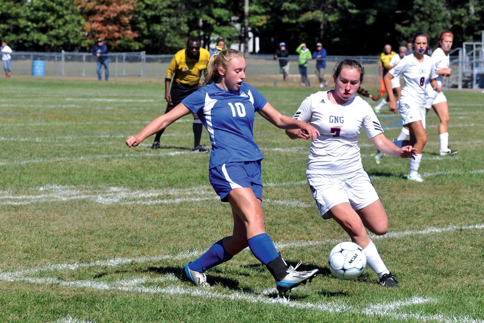Kennebunk's Sierra Tarte (10) gets rid of the ball ahead of Gray-New Gloucester's Emma Dyer during a 0-0 tie at Myles Burbank Memorial Field in Gray last Saturday.