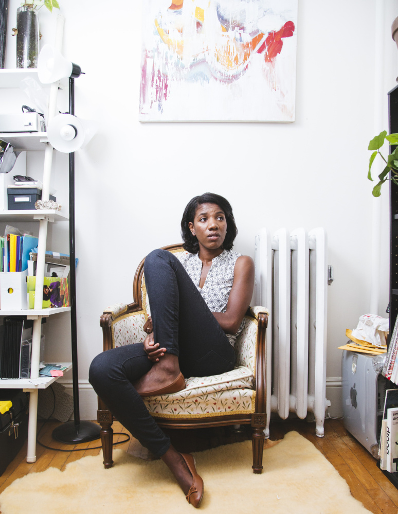 """A native of France born to Haitian parents, 28-year-old Edwige Charlot of Portland calls the art that she creates – a mixture of printmaking, painting and drawing – her """"visual Creole."""" Whitney Hayward/Staff Photographer"""