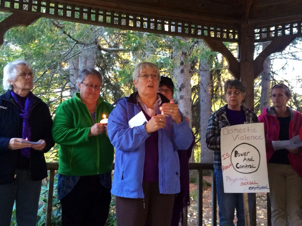 Nan Bell, a community educator at the Family Violence Project, speaks to attendees at a domestic violence awareness vigil Wednesday at Coburn Park in Skowhegan. The vigil included a moment of silence in which the names and stories of victims of domestic violence homicides this year were read aloud.