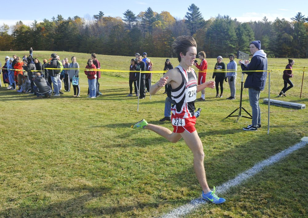John Ewing/Staff Photographer Scarborough's Colin Tardiff wins the Class A South cross country regional on Saturday at the Twin Brook Recreation Area on Saturday. Tardiff won in 16:39.54.