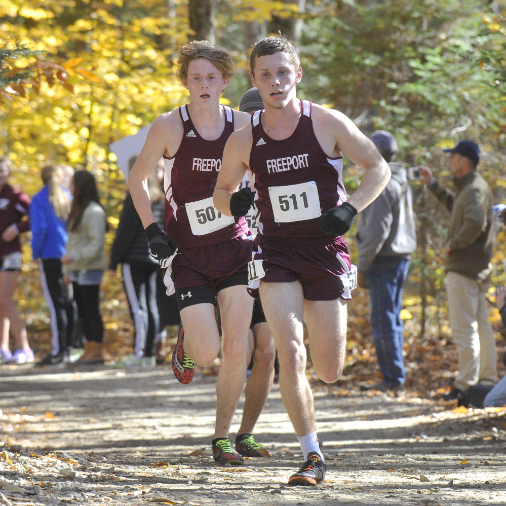 Chandler Vincent, 511, and his Freeport teammate, Henry Jaques, lead the field while leading the Falcons to a second straight Class B state title Saturday at Cumberland. Vincent covered 5 kilometers in 16 minutes, 34 seconds.