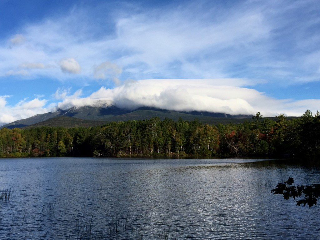 """With temperatures in the teens, Mount Katahdin's summit was enveloped in clouds early Friday morning, but that didn't stop numerous Appalachian Trail """"thru-hikers"""" from completing their hikes. The growing number of thru-hikers, and unruly behavior by a small number of them, has Baxter State Park officials concerned."""