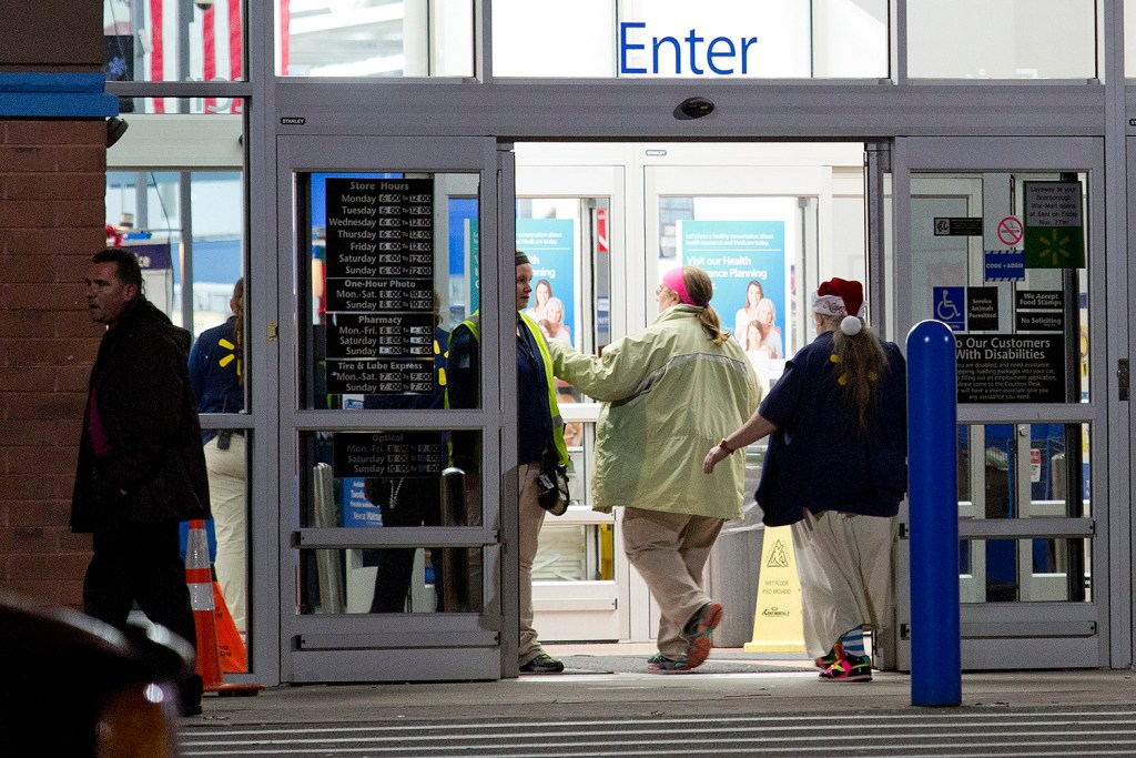 Wal-Mart employees enter the store on Gallery Boulevard in Scarborough after it was evacuated because of a bomb threat Saturday evening. Gabe Souza/Staff Photographer