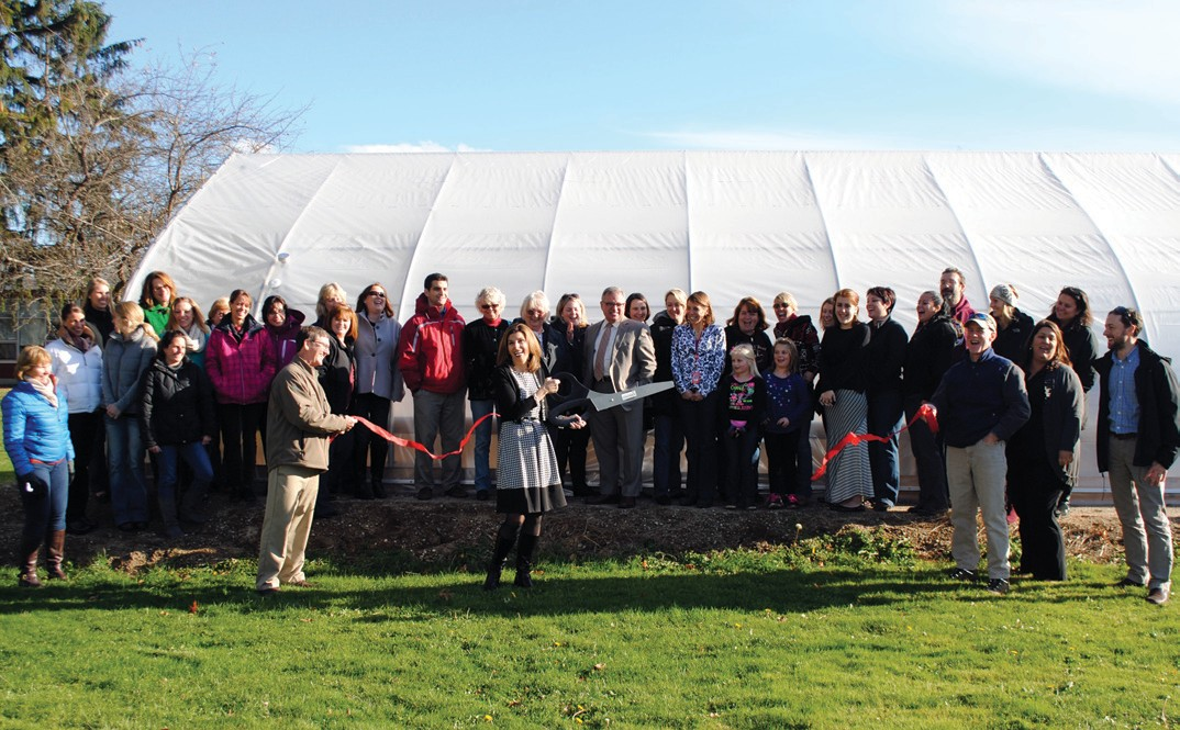 Gov. John Fairfield School Principal Maureen McMullin cuts the ribbon Tuesday afternoon at a ribbon cutting for the school's new greenhouse. The ceremony was held in conjunction with the Biddeford + Saco Chamber of Commerce + Industry.