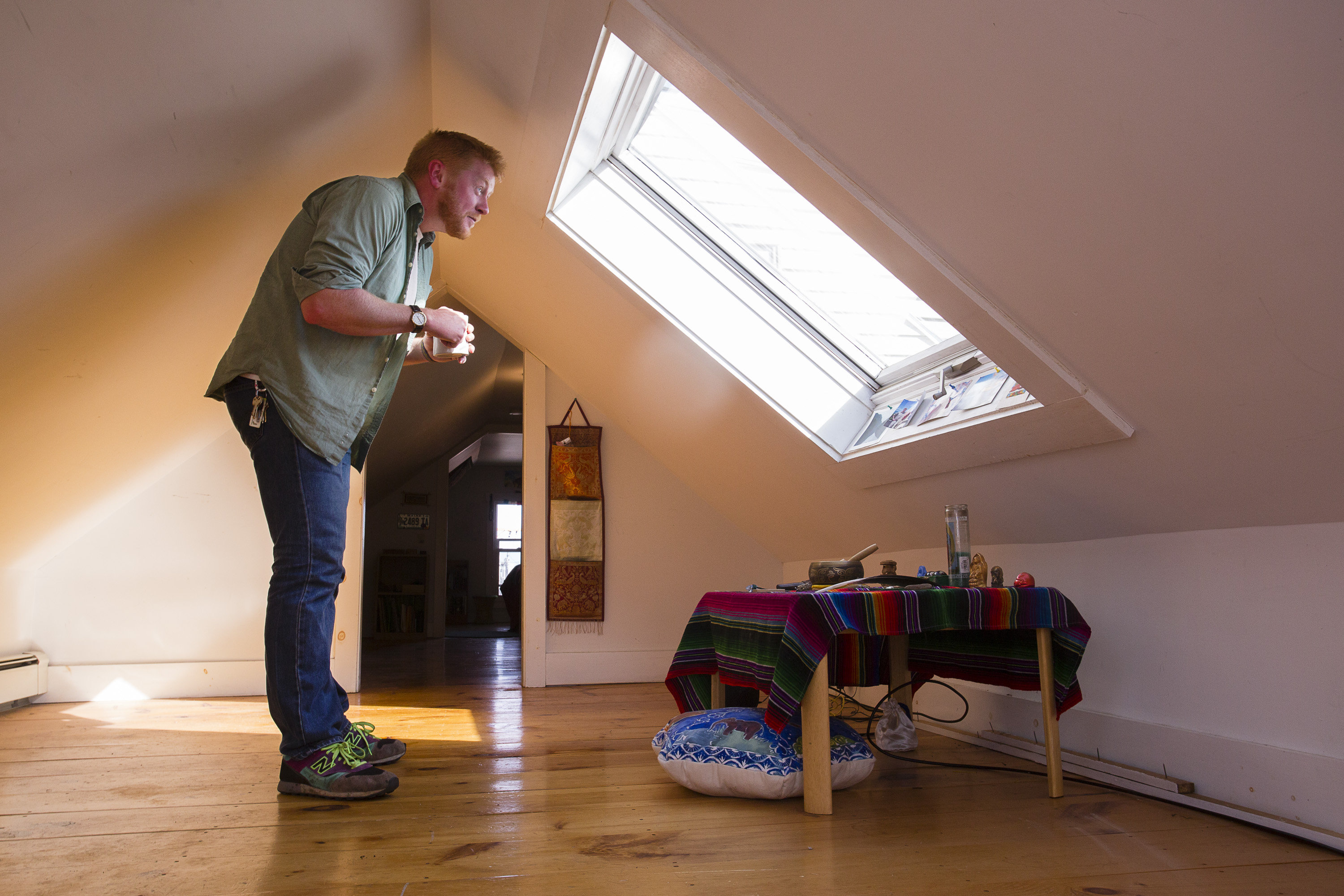 Duncan Elder, 29, in the finished attic of an apartment he shared with two roommates at 123 Congress Street.