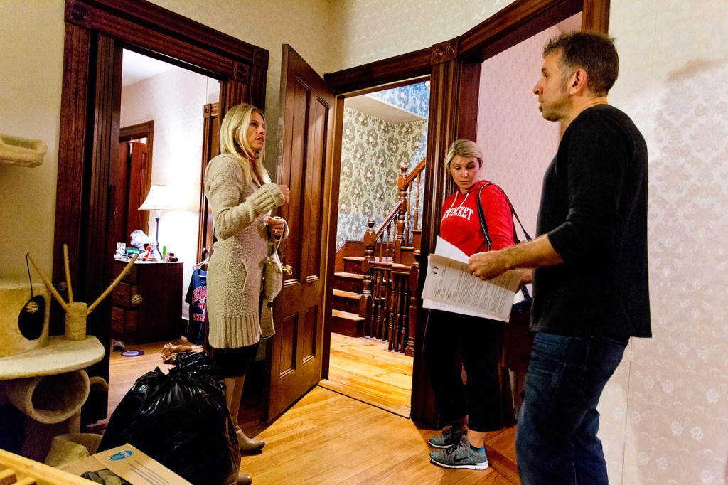 Cami Risano, left, and her husband, Pete, right, show a two-bedroom apartment to Edie Selinger, 29, of Portland