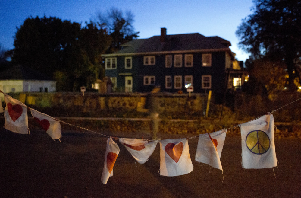 A string of flags with hearts and peace signs serves as a memorial last October marking the first anniversary of the fire on Noyes Street in Portland that killed six people in their 20s. The second Stars of Light memorial service is planned Sunday.