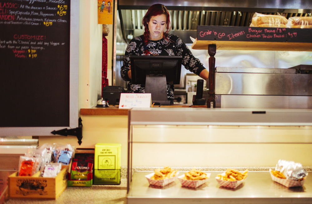 """Ambre Davidson works at Hilltop Superette in Portland, where she is paid about $10 an hour. She said she voted Tuesday in favor of a $15 minimum wage, but thinks $12 an hour is more likely to pass. It would make """"a huge impact"""" on her finances, she said."""