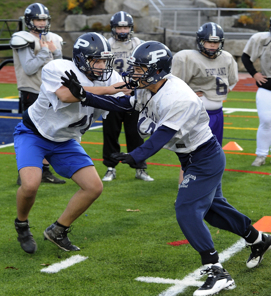 Nick Giaquinto, left, practices his offensive techniques with a defensive teammate. The Bulldogs graduated four offensive starters from a year ago, but recovered well.