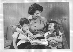 Judith Isaacson reads to her son, John, and daughter, Ilona.