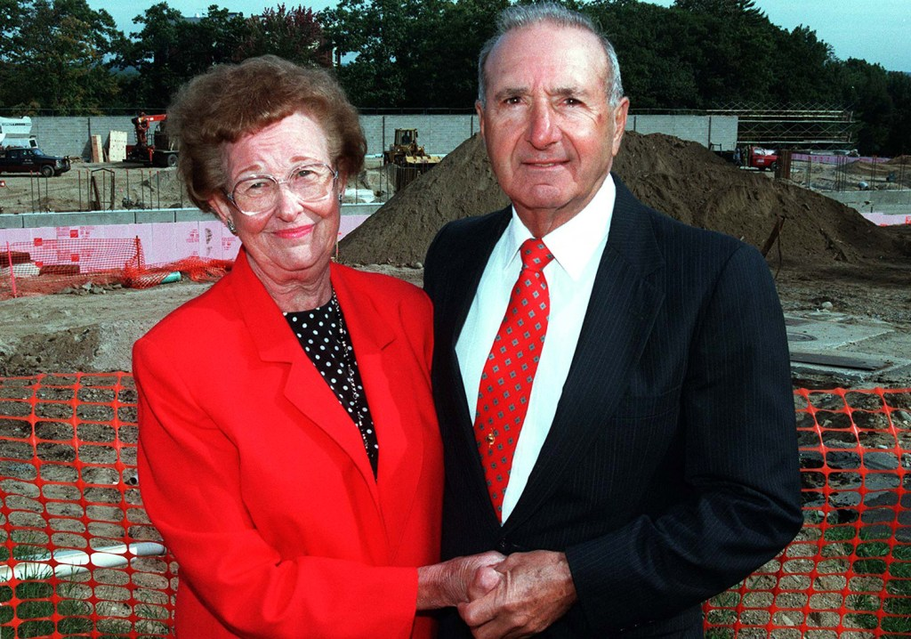 """This 1997 file photo shows Melissa and Richard """"Doc"""" Costello at the site where the University of Southern Maine field house was built in their honor. The Costellos' estate has given $1.65 million to the school to help fund improvements to the Costello Sports Complex."""