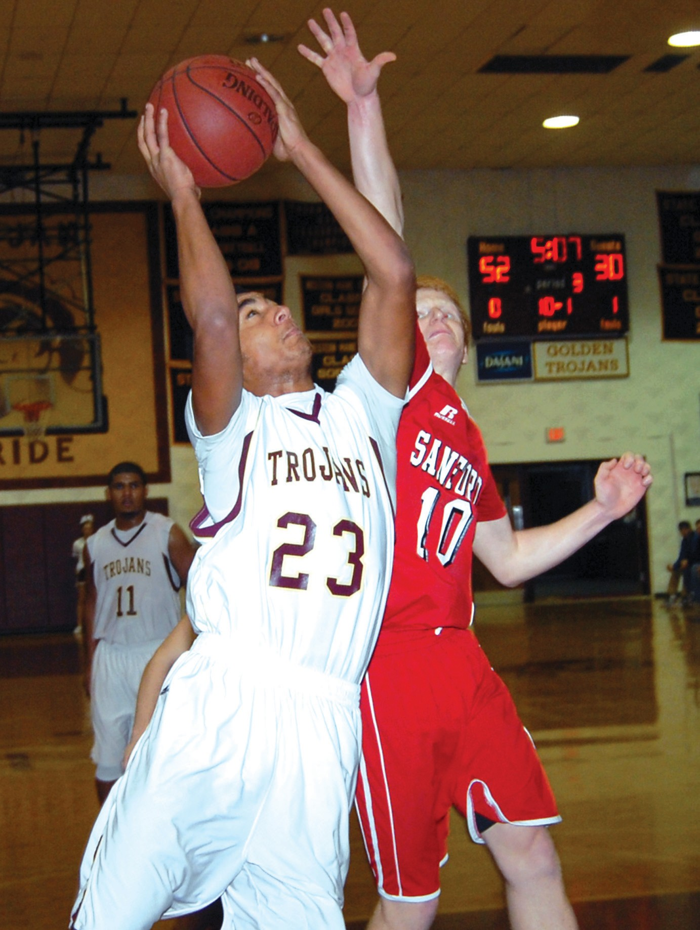 Thornton Academy's Corey Hart goes up for a shot as Sanford's Brad Bouchard defends during Friday night's game.