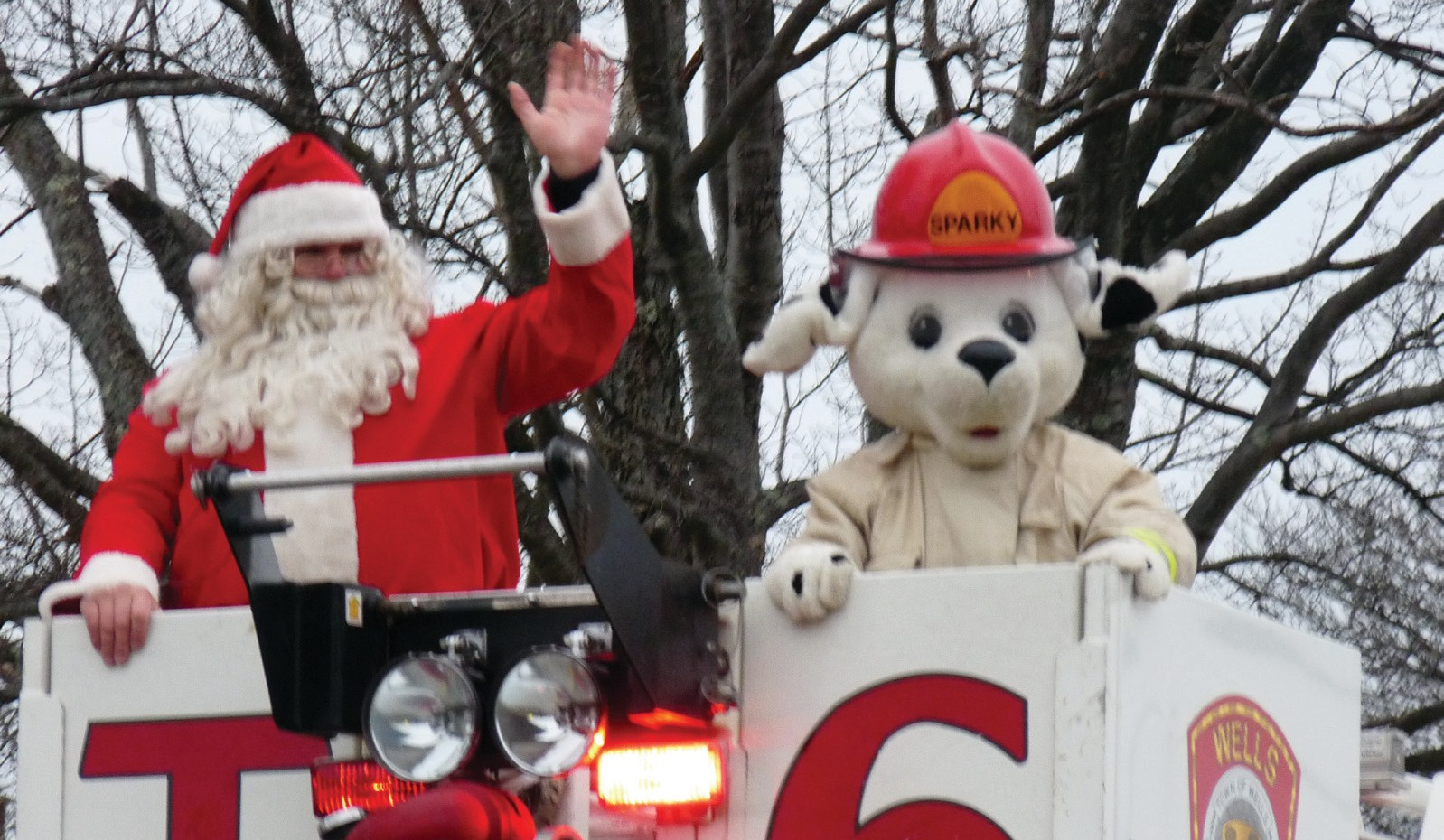 Santa waves from a firetruck at last year's Christmas parade in Wells.