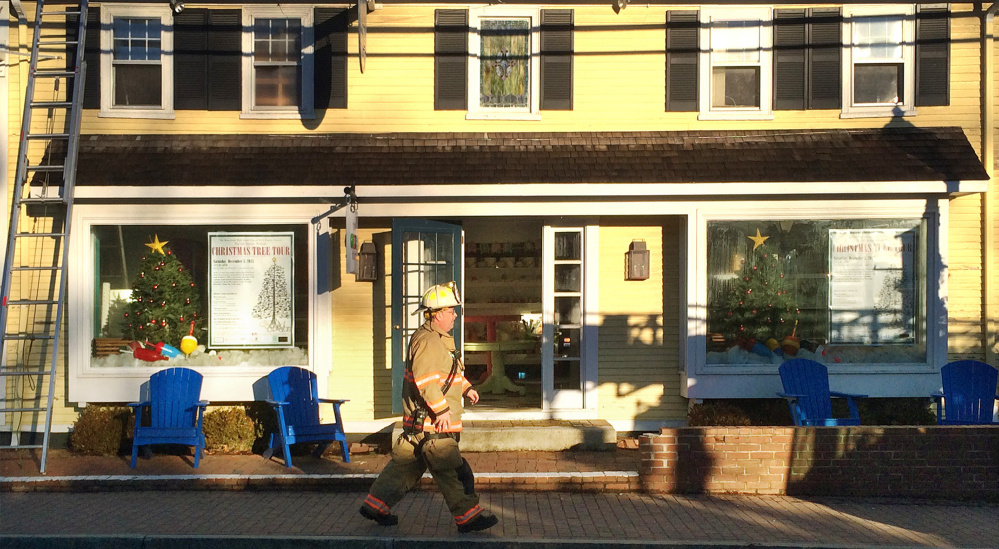 A firefighter walks past the entrance of The Sugar Shack. The Sugar Shack candy store is scheduled to be the starting point of the Prelude Christmas Tree Tour.