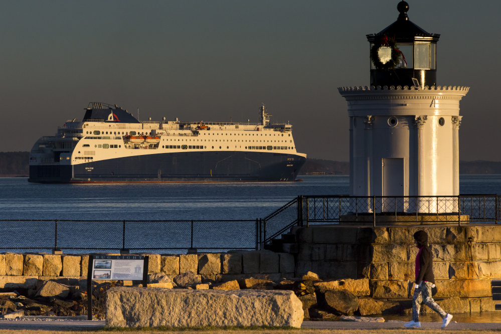 The financially embattled Nova Star drops anchor in the bay after departing Portland's Ocean Terminal at sunrise on Saturday.