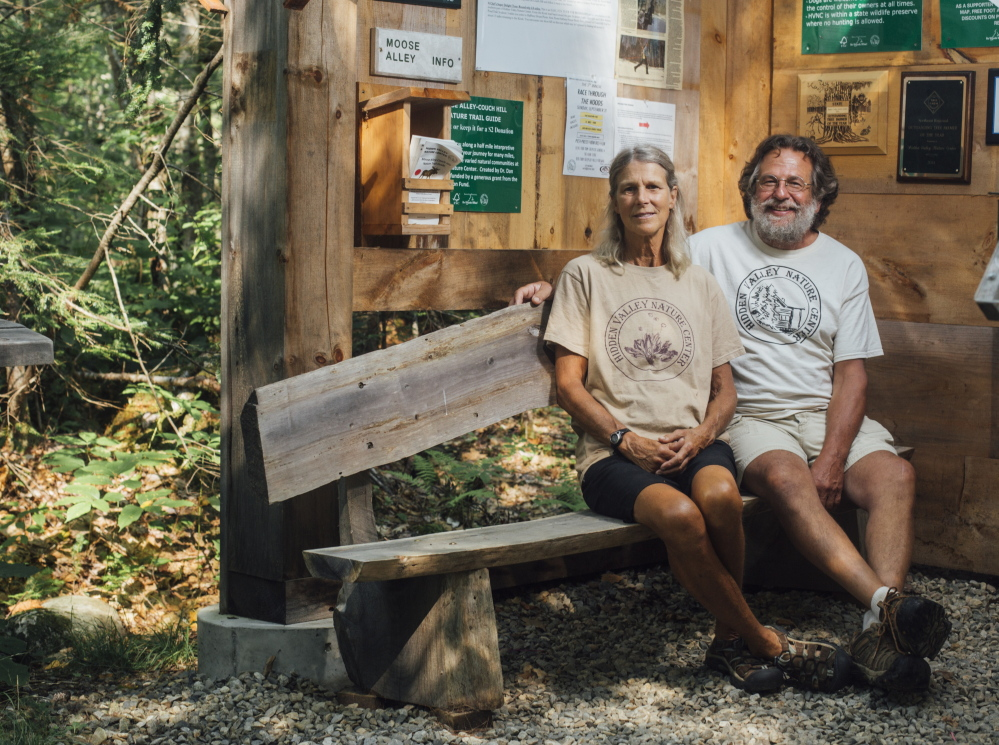 Bambi Jones and her husband, Tracy Moskovitz, sit inside the Hidden Valley Nature Center. This fall, Hidden Valley merged with three other land-protection groups to form the Midcoast Conservancy.