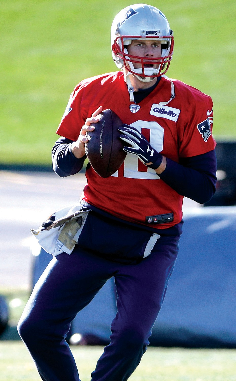 New England Patriots quarterback Tom Brady prepares to pass during an NFL football practice, Monday, in Foxborough, Mass.