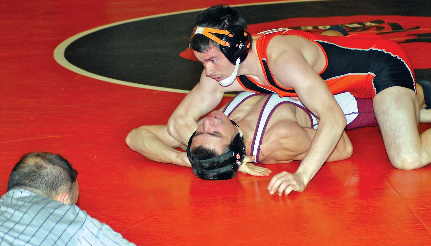 Biddeford's Brian Livermore picks up the fall during Wednesday's match against Windham.
