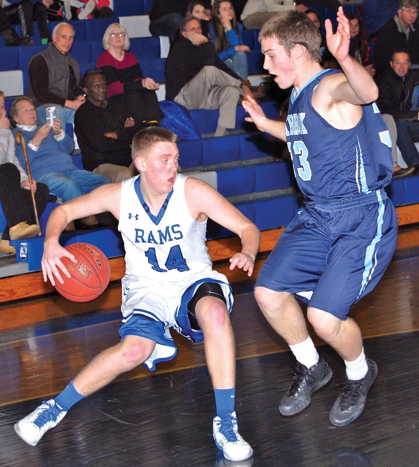 Kennebunk point guard Cam Lovejoy goes behind his back to get past Westbrook's Curtis Knapton during Monday afternoon's game. Westbrook picked up a 49-44 road win.