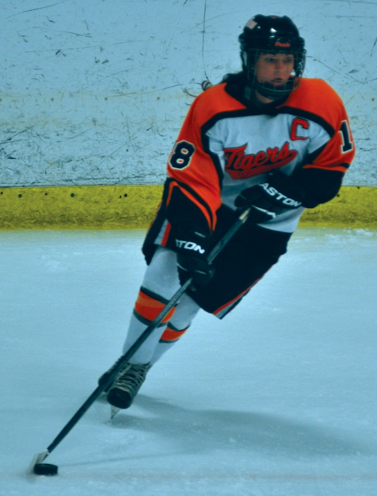 Biddeford's Taylor Turgeon takes the puck up ice in the first period on Wednesday against Falmouth.