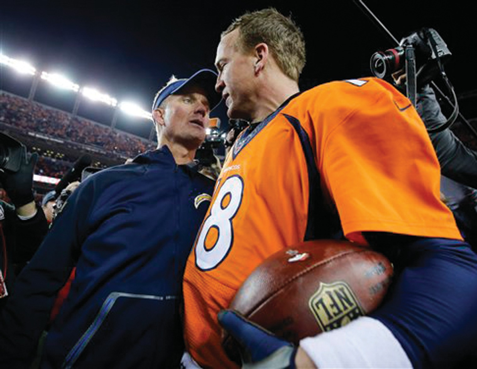 Denver Broncos quarterback Peyton Manning, right, San Diego Chargers head coach Mike McCoy after their win on Sunday in Denver.