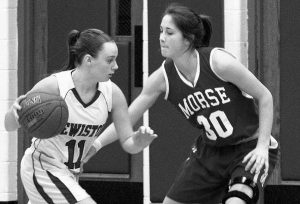LEWISTON HIGH SCHOOL'S Kristina Blais, left, makes a move around Morse High School's Isabelle Paulus during their game in Lewiston on Friday.