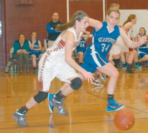 RICHMOND HIGH SCHOOL guard Meranda Martin dribbles the ball during a girls basketball game against Searsport on Monday in Richmond. The Bobcats won, 33-24, to stay unbeaten. See the girls basketball roundup on B2