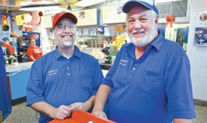 PAUL CHURCH, LEFT, AND BUSTER WILLIAMS, co-owners of Kermit's Hot Dog House, pose for a photo at the restaurant in Winston Salem, N.C.