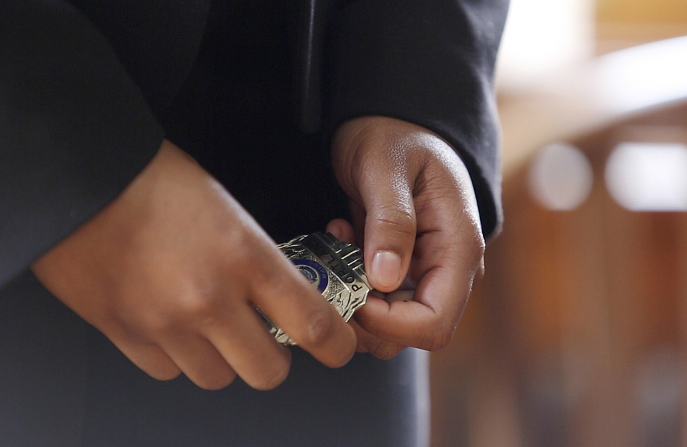 Zahra Abu still has work to do before she can wear the badge she got Friday. She must complete an 18-week training program to become a full-time police officer.