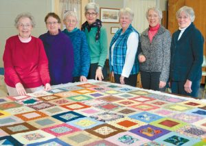 FOR NEARLY A DECADE, the People Plus quilting club has met bi-weekly at the center to work on sewing and quilting projects. For nearly as long, they have produced as a group a quilt to donate to the Music in April fundraising auction. These quilts have varied in size and color but nearly always bring in close to $500 each. They are pictured here working on this year's Music in April donation quilt. For more information on joining the quilters group or any of the programs offered at People Plus, call (207) 729-0757 or go to www.peopleplusmaine.org.