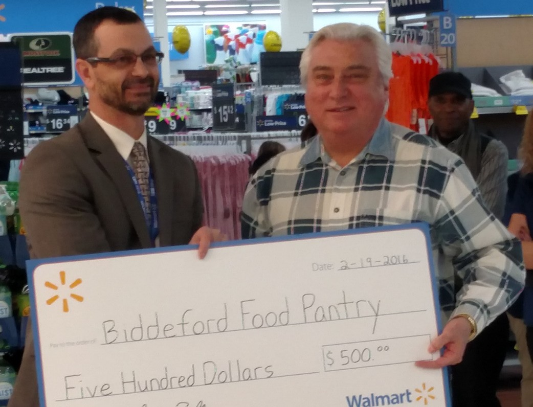 Walmart recently presented checks to Delilah Poupore of the Heart of Biddeford, left, and Don Bisson of the Biddeford Food Pantry, right.