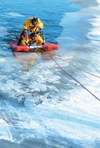 RICHMOND FIRE CAPT. DOUG RIOUX and Jason Patterson are pulled from open water on a rescue sled during a cold water rescue training exercise on Pleasant Pond on Saturday.
