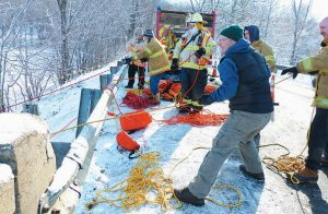 MEMBERS OF THE Richmond Fire Department run ropes tethered to those participating in Saturday's training.