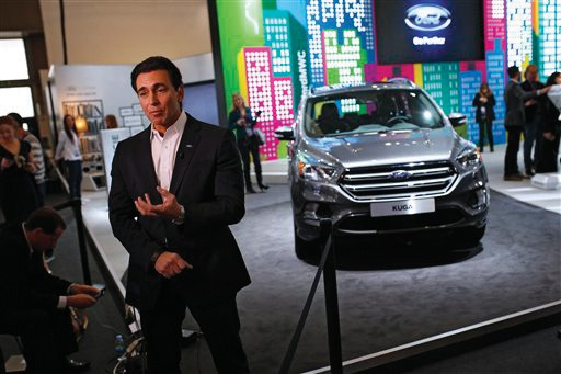 Ford CEO Mark Fields talks during an interview next to the new Kuga SUV car, which features its latest connectivity and driver-assisted technology, during the Mobile World Congress Wireless show, the world's largest mobile phone trade show, in Barcelona Monday.