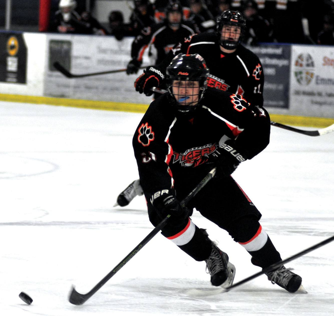 Biddeford's Rick Ruck tracks down the puck in the third period Monday against Cheverus in the Class A South playoffs.