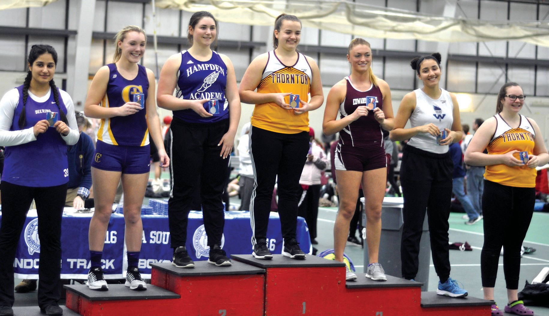 Thornton Academy's Samantha Curran and Isabella Capozzi receive medals for the shot put Monday afternoon.