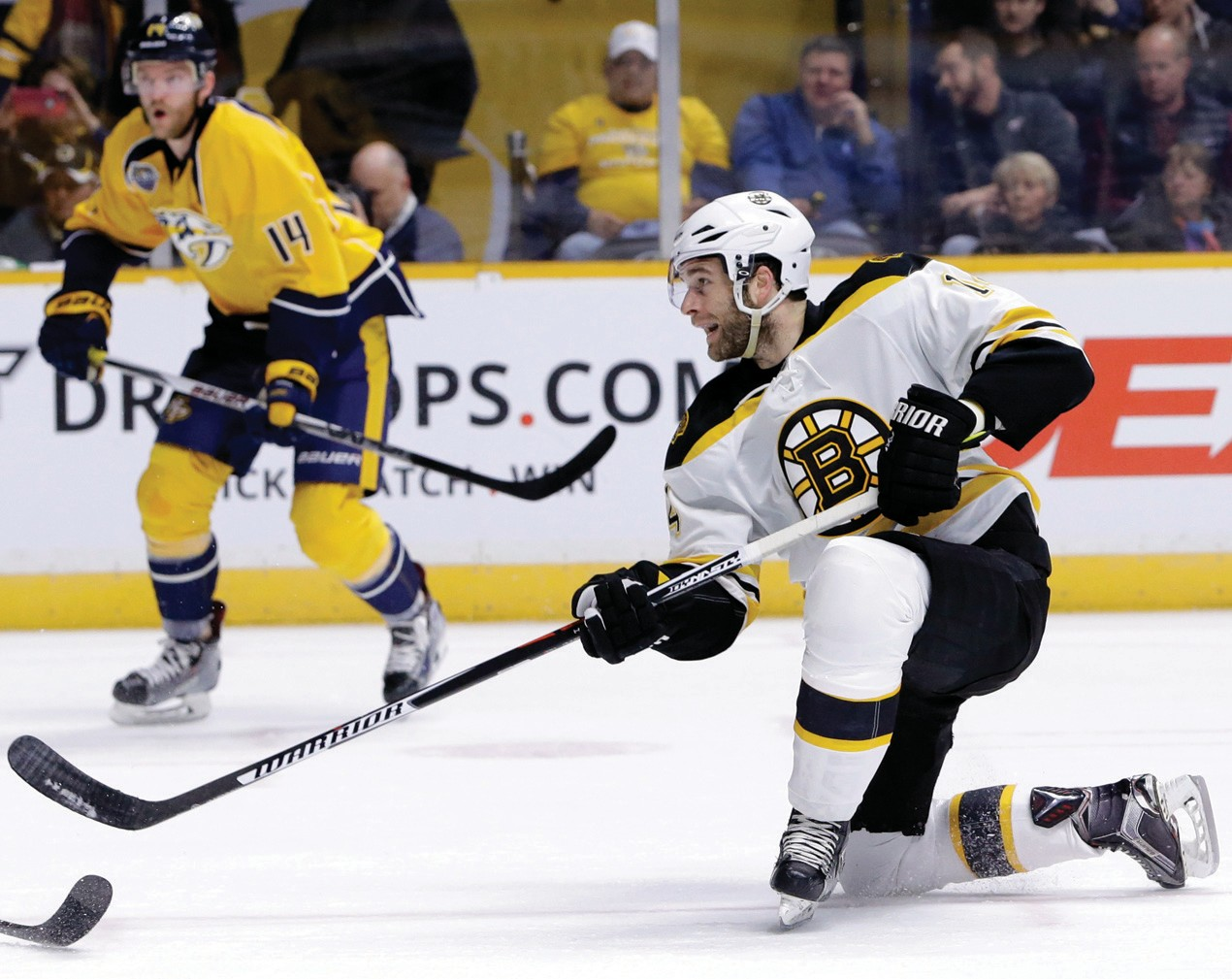 Boston Bruins right wing Brett Connolly, front, shoots against the Nashville Predators in the first period on Thursday.