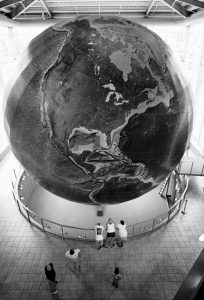 """VISITORS GAZE UP at the 42-feet-high rotating globe named """"Eartha,"""" in the lobby of the DeLorme headquarters in Yarmouth, in this 1998 file photo. Swiss-based Garmin Ltd., said Thursday it is purchasing the Maine-based mapmaker and maker of hand-held satellite communications. Garmin said DeLorme will operate as a research and development facility and that most of its workers will be retained. DeLorme will continue producing its state-specific Atlas and Gazetteer series, but will close its map store. The company's lobby, featuring the globe, will remain open to the public."""